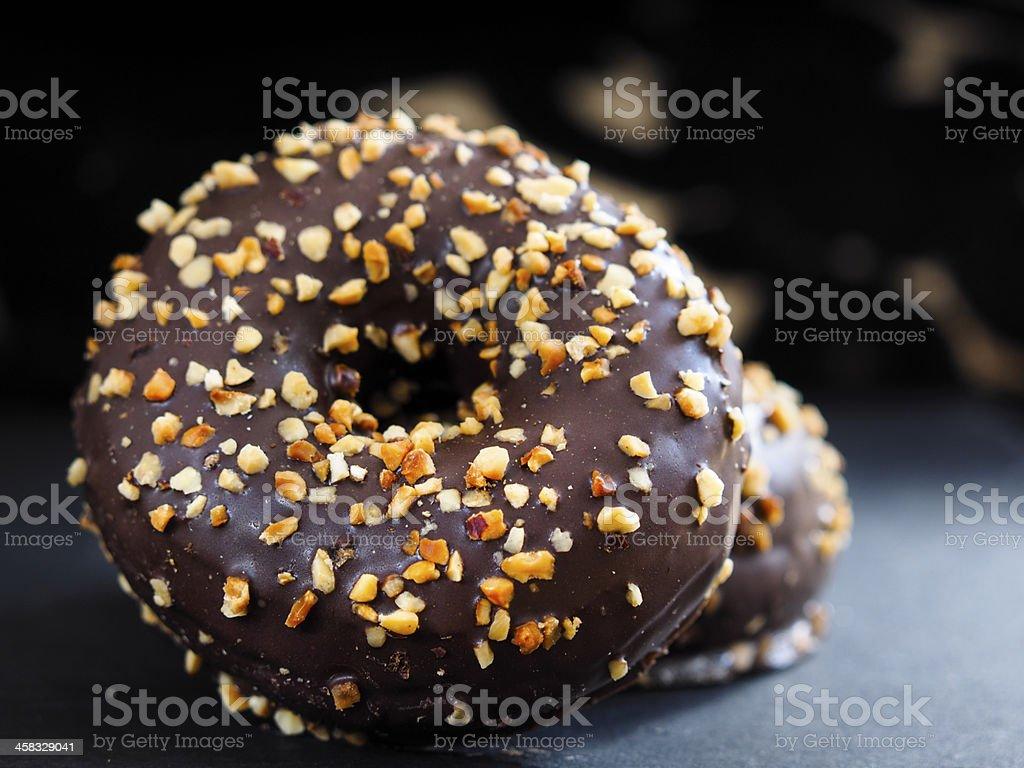 choc and hazelnut doughnut stock photo