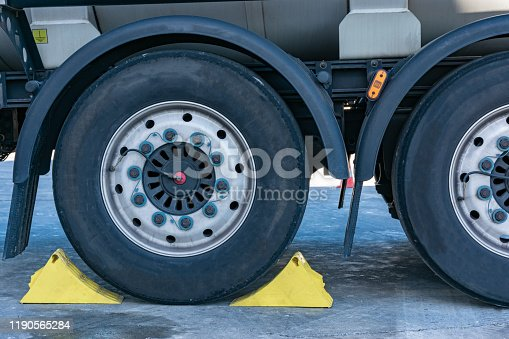 Truck wheel immobilized with chocks