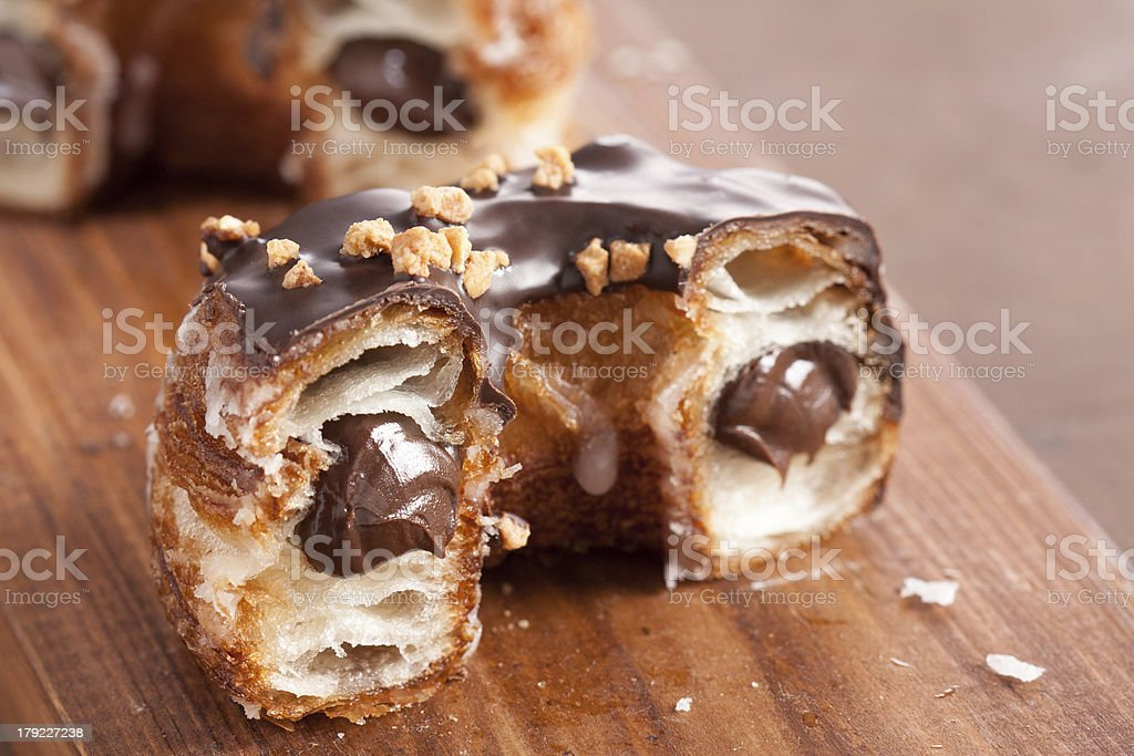 Chocolate almond croissant and doughnut mixture stock photo