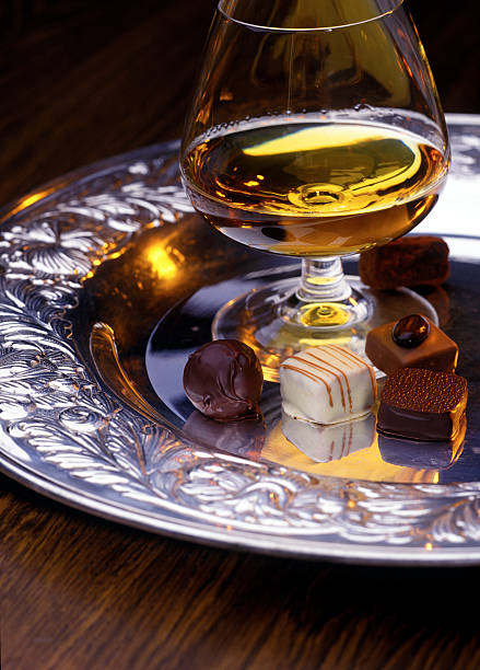 chocolate and cognac chocolate and cognac calvados stock pictures, royalty-free photos & images