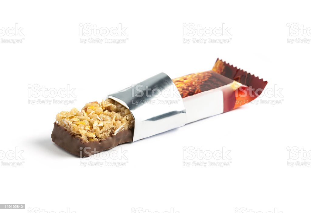 Chocolate and oat energy bar with wrapper opened royalty-free stock photo