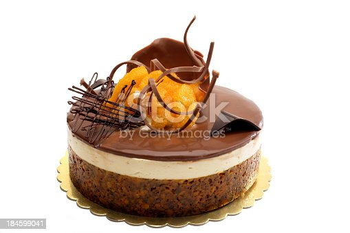 close up shot of chocolate and orange cake over white background.