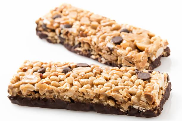 chocolate and peanut butter energy bar - kauwgomachtig stockfoto's en -beelden