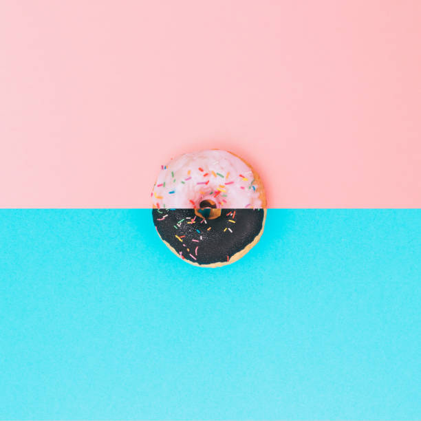 chocolate and pink donuts with topping stock photo