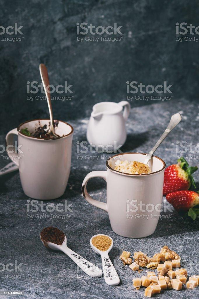 Chocolate and vanilla mug cakes stock photo