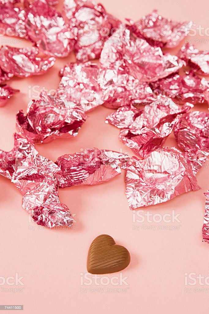 Chocolate and wrappers stock photo