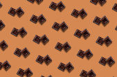 Chocolate bar block square pattern on brown background