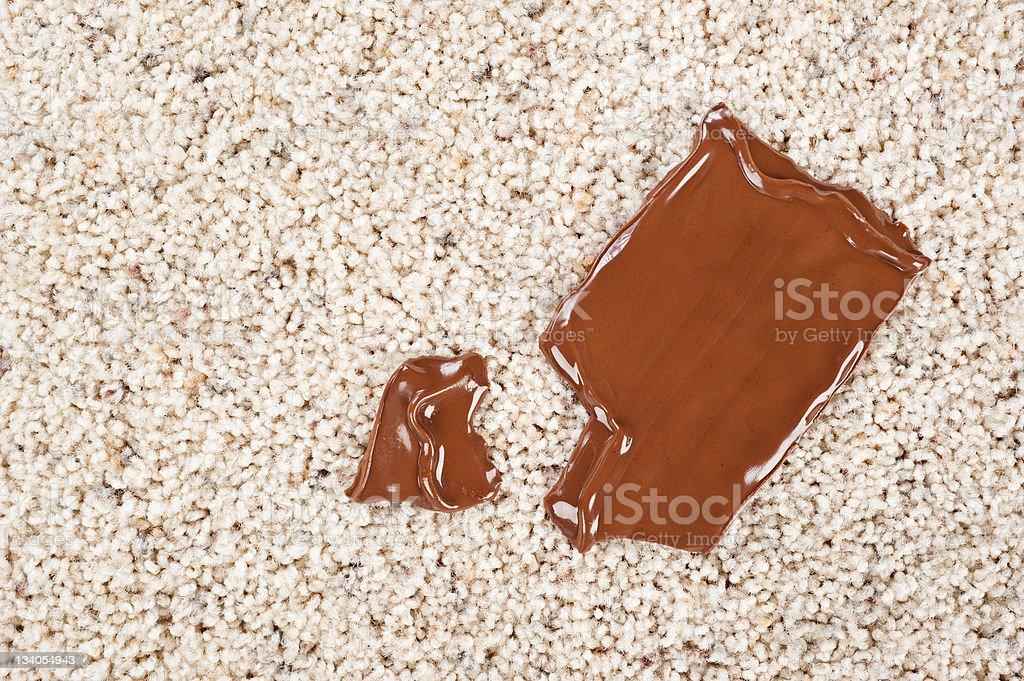 Chocolate bar dropped on carpet stock photo