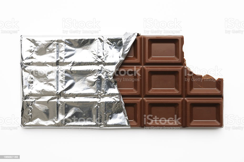 Chocolate bar with a missing bite on white background stock photo