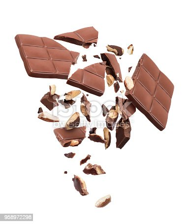 istock Chocolate bar with nuts broken into pieces in the air, isolated on a white background 958972298