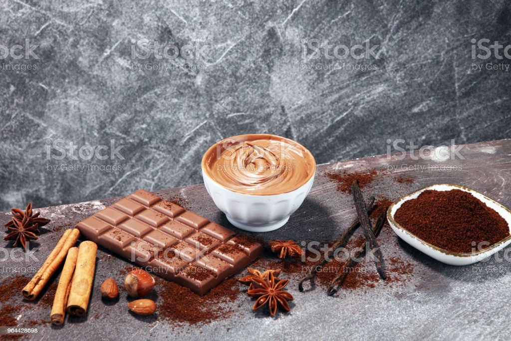 Chocolate bars on table with chocolate powder. - Royalty-free Almond Stock Photo