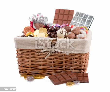 Delicious basket filled with chocolate and candies.  Shallow dof.