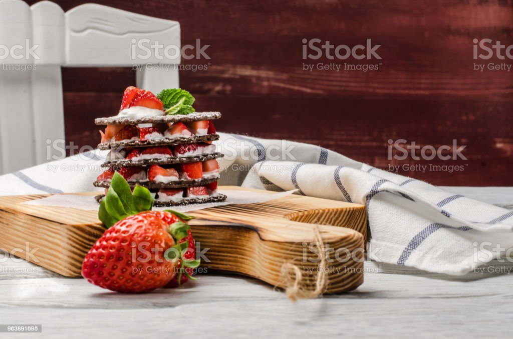 Chocolate belgian waffles with strawberries, whipped cream and mint leaf - Royalty-free Baked Stock Photo