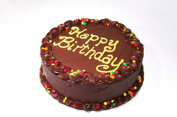 Chocolate birthday cake isolated on white stock photo