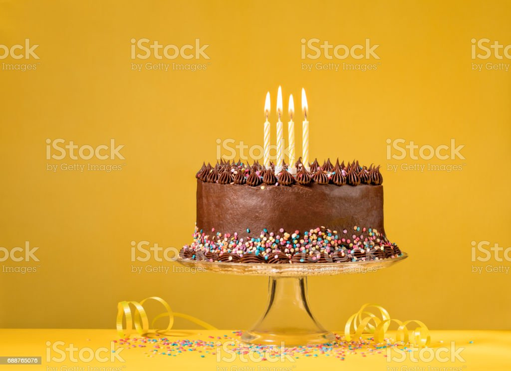 Chocolate Birthday Cake on Yellow stock photo