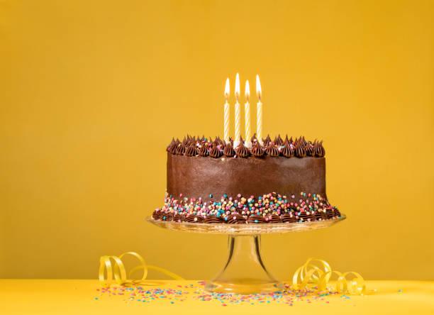 Chocolate Birthday Cake on Yellow stock photo