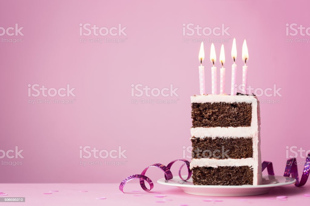 Chocolate birthday cake with pink candles stock photo