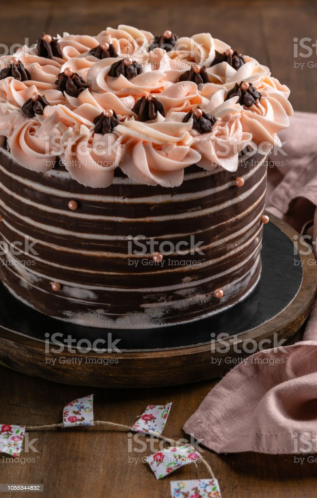 Chocolate Birthday Cake With Roses Served On Wooden
