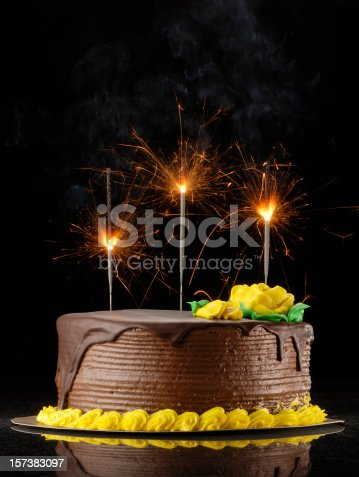 Chocolate Birthday Cake With Sparklers On A Black Background Stock Photo More Pictures Of