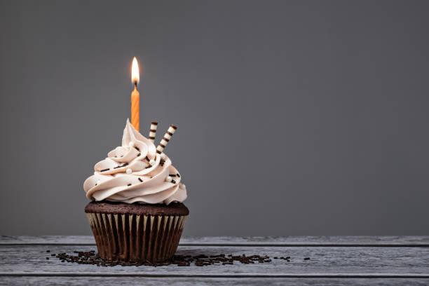 chocolate birthday cupcake - cupcake stock photos and pictures