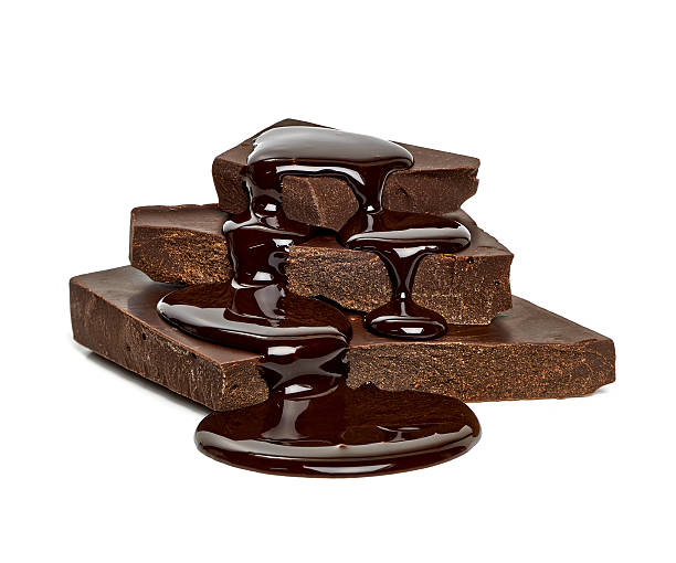 chocolate blocks with flowing sauce - chocoladesaus stockfoto's en -beelden