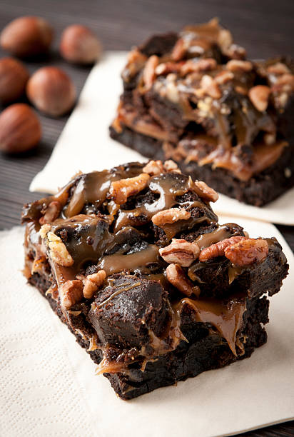 Chocolate brownie caramel sauce and nuts stock photo