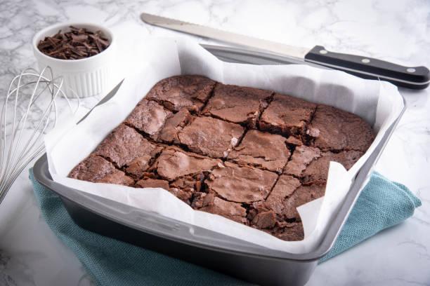 chocolate brownie in steel pan stock photo