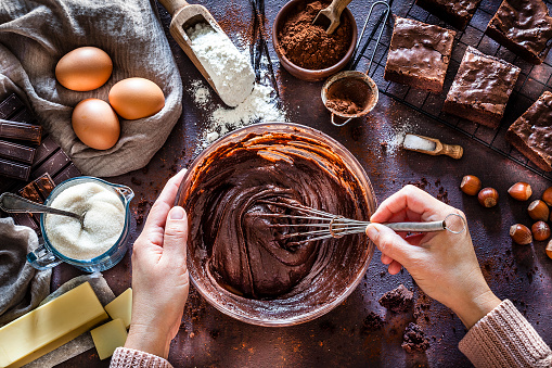 Chocolate brownie preparation on kitchen table