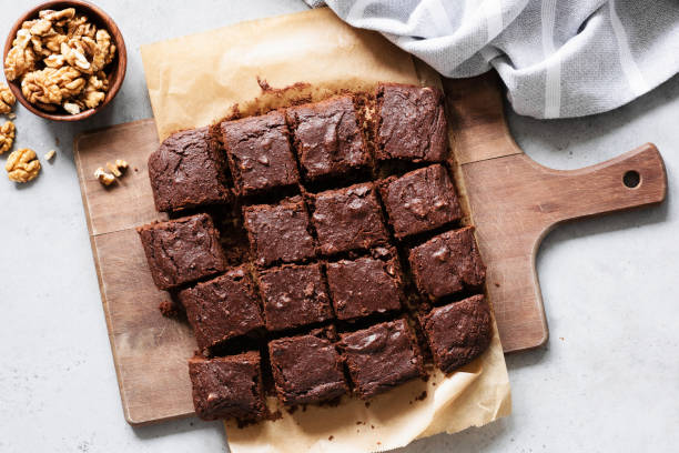 chocolate brownie squares on cutting board, top view - pudim imagens e fotografias de stock