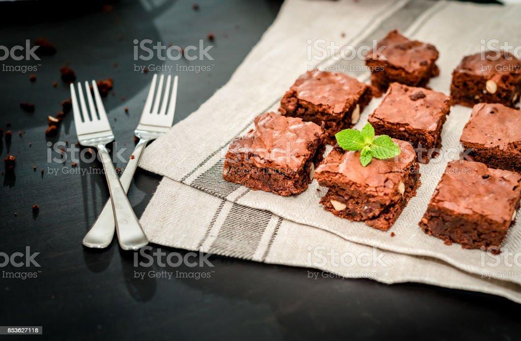 chocolate brownie with hazelnuts and almonds stock photo