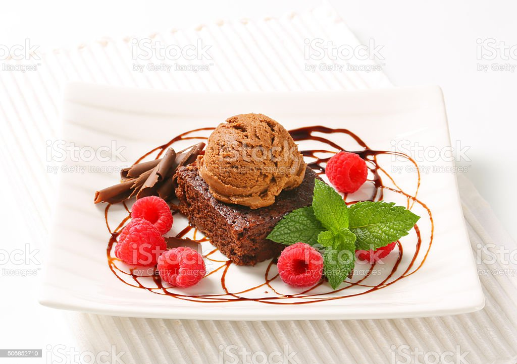 Chocolate Brownie with ice cream and raspberries stock photo