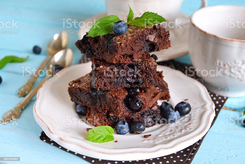 chocolate brownie with strawberries on a light background royaltyfri bildbanksbilder