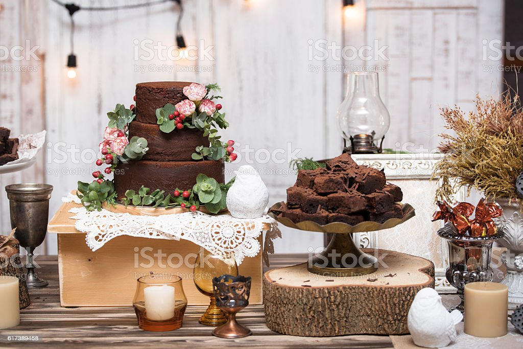 chocolate brownies in stacked on wooden table - foto de acervo