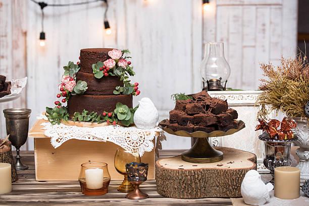 chocolate brownies in stacked on wooden table - hausgemachte hochzeitstorten stock-fotos und bilder