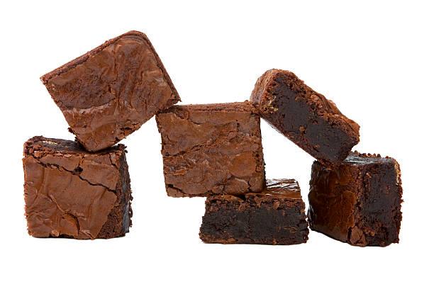 chocolate brownies stacked in front of a white background - brownie bildbanksfoton och bilder