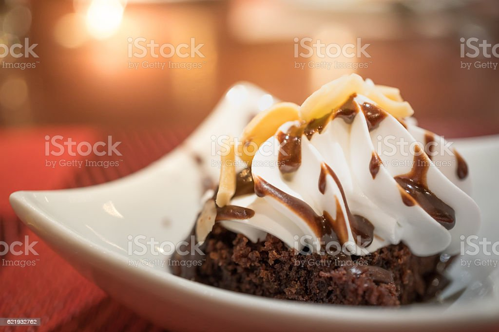 Chocolate brownies with sliced almond and vanilla ice cream stock photo