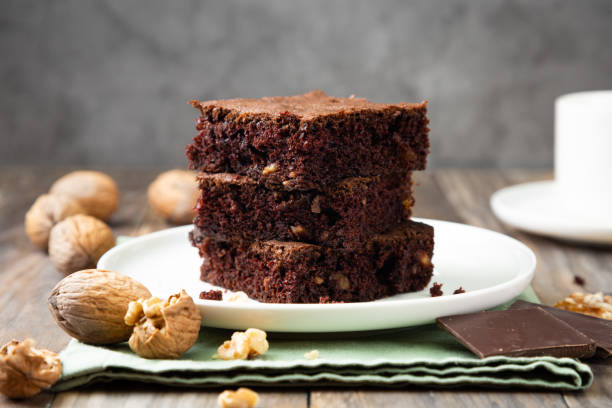 Chocolate brownies with walnuts on a stack stock photo