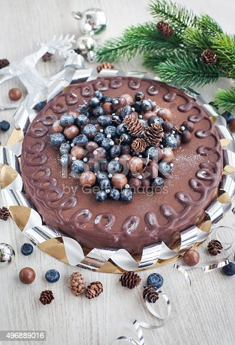 472311978 istock photo Chocolate cake decorated with fresh berries 496889016