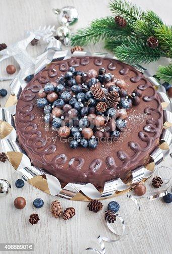 480972628 istock photo Chocolate cake decorated with fresh berries 496889016