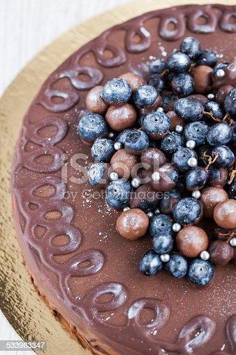 472311978 istock photo Chocolate cake decorated with fresh berries 533963347
