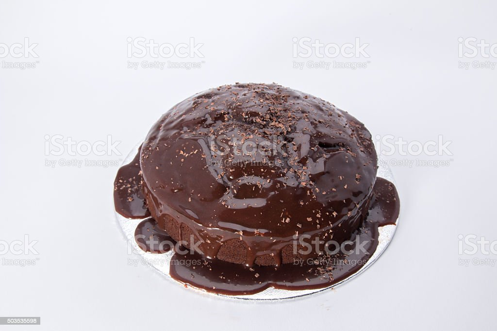 chocolate cake iced with granache and grated chocolate stock photo