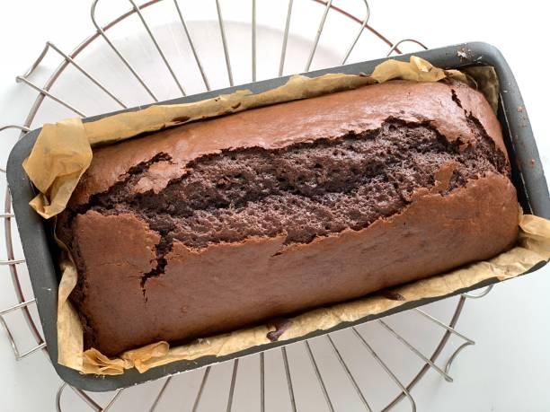 chocolate cake in baking pan stock photo