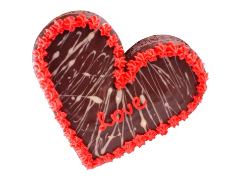 Chocolate cake in the shape of a heart with the word love