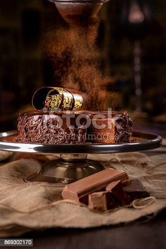 istock Chocolate cake on dark background 869302170