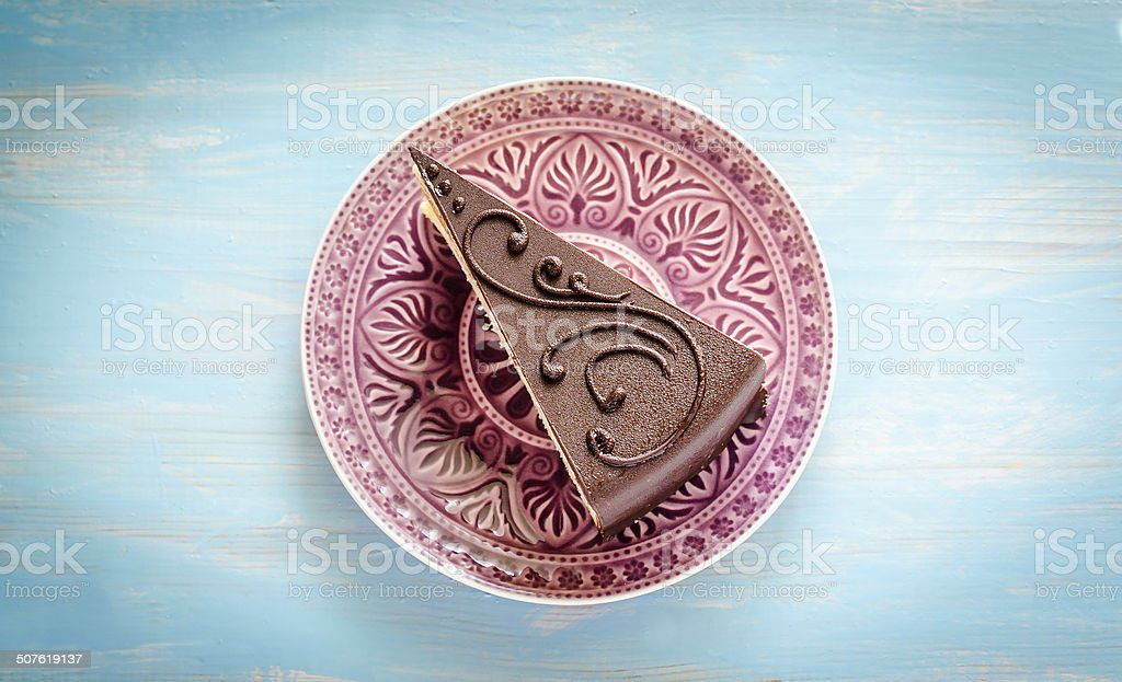 Chocolate cake on the purple plate stock photo