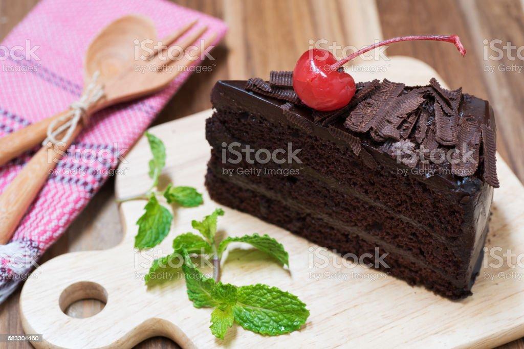 chocolate cake on wooden plate royaltyfri bildbanksbilder