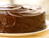 Close-up of frosting on plated chocolate cake