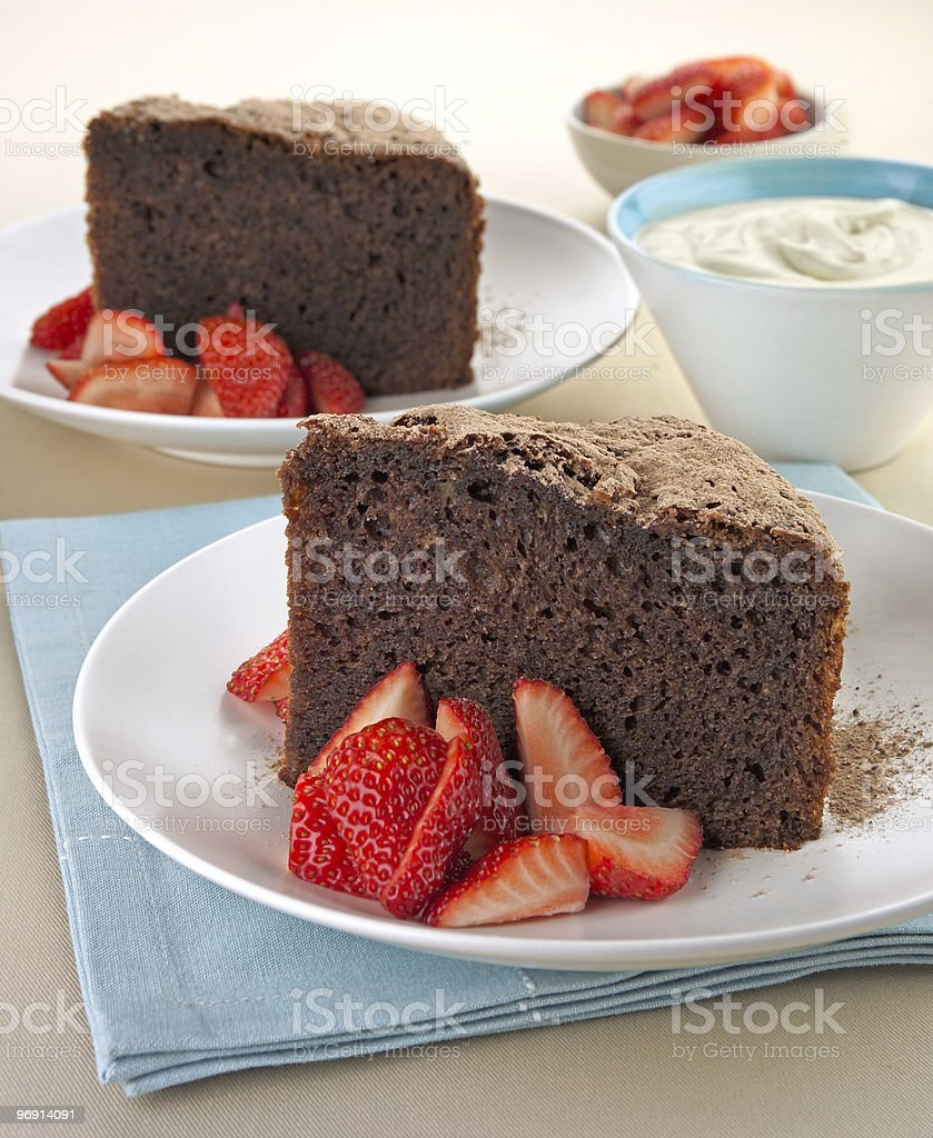 Chocolate cake slices with strawberry and cream royalty-free stock photo