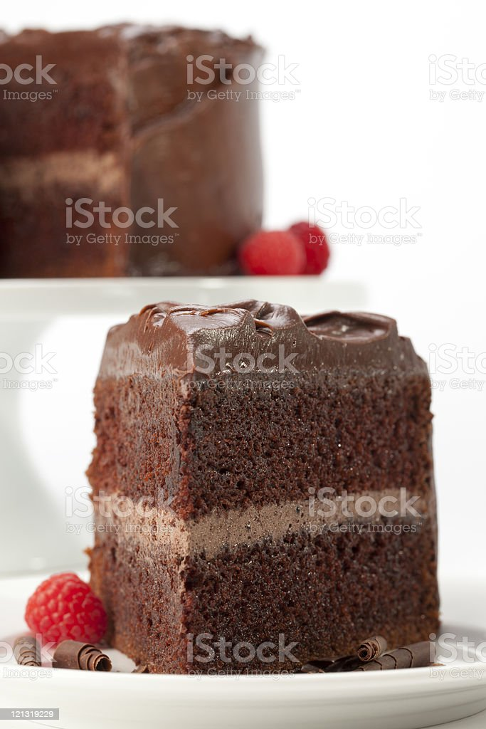Chocolate cake vertical with 3 raspberries royalty-free stock photo
