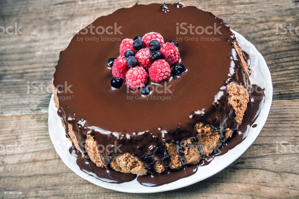 chocolate cake with berries on plate stock photo
